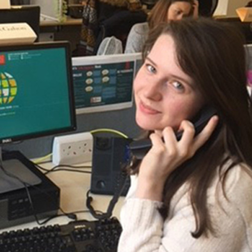 Emma, from Legacy Team, on the phone with the donor