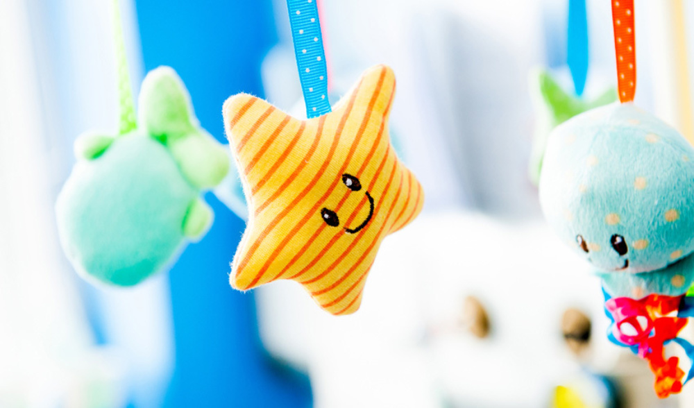 Close up of toys in a baby's cot